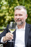 Man with a glass of wine Stock Photo