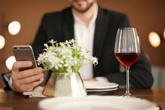 Man with glass of wine at table in restaurant. Professional sommelier Royalty Free Stock Image
