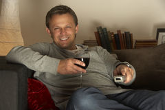 Man With Glass Of Wine Watching Television Royalty Free Stock Photo
