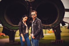 Man with glasses aviators posing. Beside women in leather jacket Stock Photography