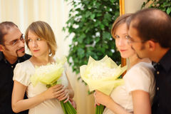 Man in glasses and beauty blond girl with flowers Stock Image