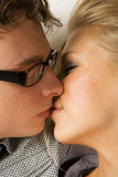 Man in glasses and blond girl kissing Royalty Free Stock Photography