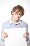 Man in glasses and blue shirt with sheet of paper Stock Image