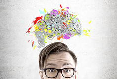 Man in glasses, brain and cogs Stock Images