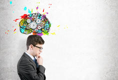 Man in glasses and brain with gears Stock Photography