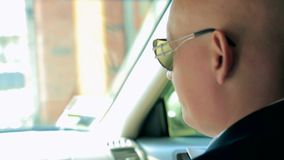 Man In Glasses In a Car stock video footage