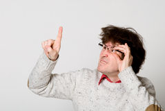 Man with glasses and with disheveled hair Stock Images
