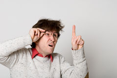 Man with glasses and with disheveled hair Royalty Free Stock Images