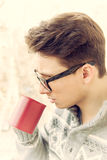Man with glasses drinking coffee outdoors Stock Images