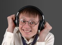 Man in the glasses emotionally listens to the music Royalty Free Stock Image