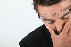 Man in glasses expressing dread Royalty Free Stock Images