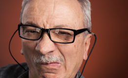 Man in glasses with a grimace of pain Stock Photos