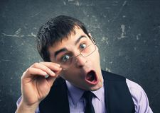 Man in glasses grimacing Royalty Free Stock Images