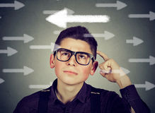 Man in glasses has a second thought choice. Young man in glasses has a second thought choice Royalty Free Stock Photo