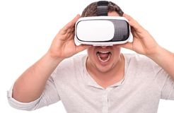 Man in glasses or helmet of virtual reality on a white. Stock Photography