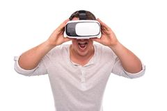 Man in glasses or helmet of virtual reality on a white. Royalty Free Stock Photography
