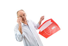 Man in glasses hold red paperbag Royalty Free Stock Images