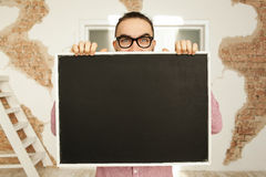 Man in glasses holding blank blackboard in hands Royalty Free Stock Photo