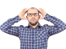 Man with glasses holding his head with his hands. Royalty Free Stock Photos