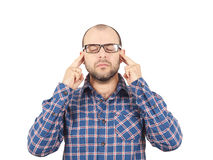 Man with glasses holding his head with his hands. Stock Photo