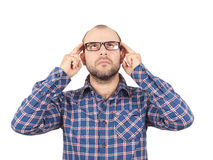 Man with glasses holding his head with his hands. Stock Image