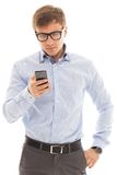 Man in glasses holding a phone Stock Photography