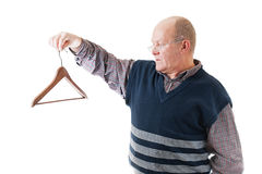 Man in glasses holds cloth hanger. Confident man in glasses holds in hand empty cloth hanger isolated on white Royalty Free Stock Photo