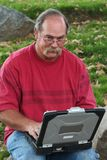 Man with glasses on laptop royalty free stock photos