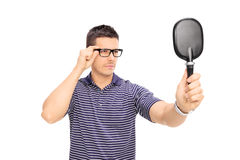 Man with glasses looking himself in a mirror Royalty Free Stock Image