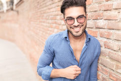 Man with glasses looks to  side and laughs Stock Image