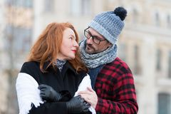 Guy in looks to woman face. Husband embraces wife on street. Urban family on street look into eyes. Sweet emotion. Man in glasses looks to women face. Husband stock photo