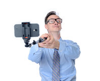 Man in glasses making selfie with a stick Stock Photography