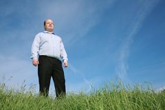 Man in glasses on a meadow Royalty Free Stock Photo