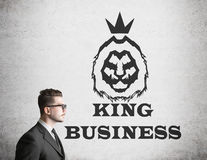 Man in glasses near king of business sketch Royalty Free Stock Photos