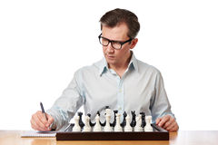 Man in glasses playing chess Royalty Free Stock Image