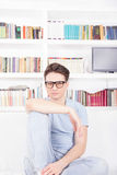 Man with glasses posing in front of library Stock Photography