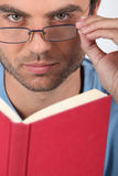Man with glasses reading Royalty Free Stock Image