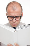 Man with glasses reading a book Royalty Free Stock Photography