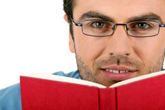Man with glasses reading book Stock Photos