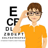 Man with glasses reading sight test characters Royalty Free Stock Images