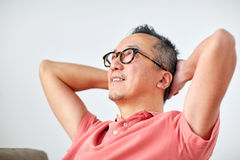 Man in glasses relaxing or dreaming at home Stock Photo