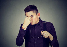 Man with glasses rubbing his eyes feels tired Royalty Free Stock Images