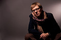 Man in glasses and scarf. Separated over gray background royalty free stock images