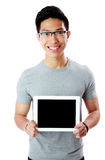 Man in glasses showing tablet computer screen Stock Images