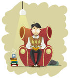 Man in glasses sits in chair and read book Stock Images