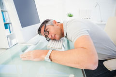 Man with glasses sleeping on the keyboard Stock Photography