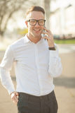 Man with glasses speak on mobile phone in hands Stock Photo