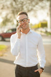 Man with glasses speak on mobile phone in hands Royalty Free Stock Photography