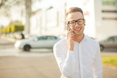 Man with glasses speak on mobile phone in hands Royalty Free Stock Images