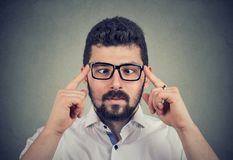Man in glasses with strabismus. Closeup portrait of a handsome guy in glasses with strabismus royalty free stock photo